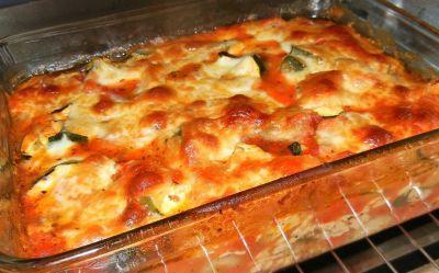 Calabacines con tomate y queso fundido